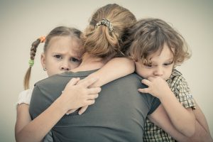sad children hugging his mother